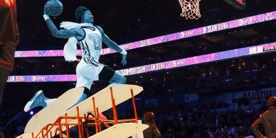 John Collins jumps over an airplane in the 2019 NBA All Star Dunk Contest